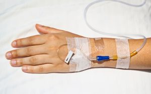 Medical intravenous cannula in his hand a sick person